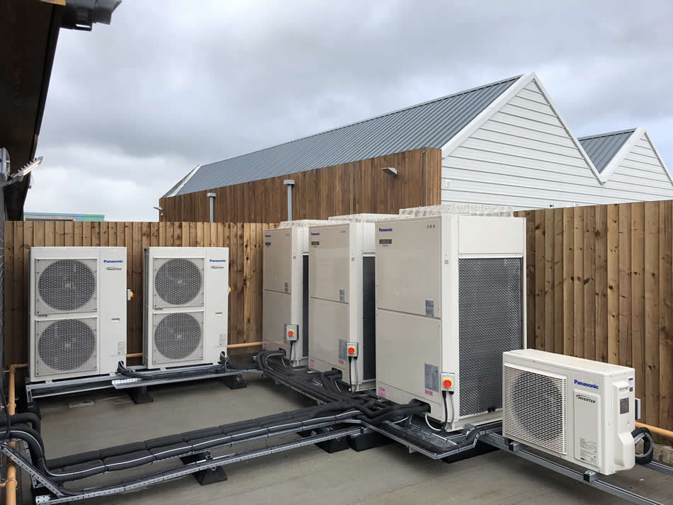 VRF and Split system condensing unit installation.